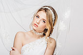 Portrait of Beautiful Young Fashion Sexy Bride Isolated . Jewelry and accessories
