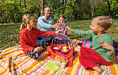 Happy family enjoy picnic in beautiful nature