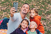 Father making selfie with kids