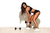 Fit Women Exercise With Weights
