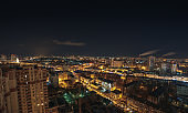 Panoramic view of  big city at night with illuminated modern architecture
