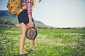 Close up of woman walking through grass