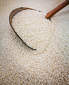 White sesame seeds and wood spoon