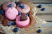 Macaroon with fresh blueberries and chocolate