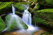 Waterfall on mountain stream.
