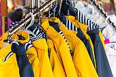 Bright raincoats hanging at a fashion store