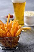 french fries, beer, mayonnaise and ketchup