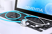 stethoscope on laptop keyboard with screen showing dementia