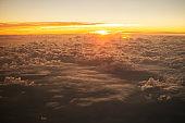 Sunrise above cloudscape