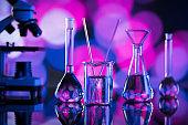Science concept. Laboratory beakers. Colorful bokeh
