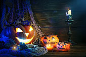 Halloween pumpkins on a wooden table at night