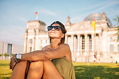 Beautiful woman traveling around Germany and visiting Berlin
