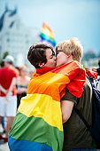Gay pride parade in Budapest, Hungary - Lesbian couple expressing emotions on gay parade