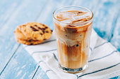 Iced latte on wooden table