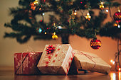 Christmas tree and holidays present on wooden flat