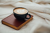 Coffee latte on the bed