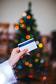 Woman holding credit card at christmas