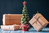 Gift boxes on kraft paper with christmas tree
