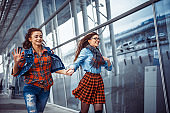 Girls having fun and happy when they met at the airport.Art proc