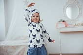 Cute little girl dreams of becoming a ballerina. Girl studying ballet.