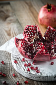Pomegranate on the wooden board