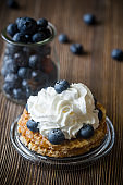 Waffle with whipped cream and blueberries