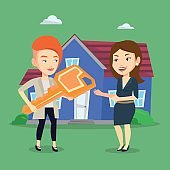Real estate agent giving key to new house owner