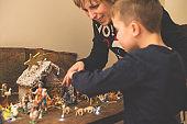 Christmas - Mother and son making crib