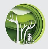 tree with swinging kid , paper art style.vector illustration