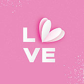 LOVE Typographic Lettering With White Paper Cut Heart. Happy Valentine's Day Greetings Card. Romantic Holidays. Pink background. 14 February.