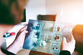 Futuristic tablet with see through display controls smart home items