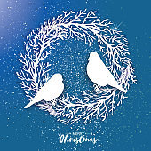 3D Origami Christmas Wreath with Bullfinch. Paper cut tree branch. Birds silhouette, Happy New Year. Winter snowflakes. Circle carving frame. Space for text. Blue background. Vector
