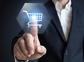 Businessman touching e-commerce button on a virtual interface with icons of shopping cart, delivery, credit card and wireless web, concept about online purchase on internet