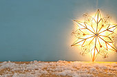Image of christmas shining star over wooden background.