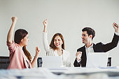 Business people smile and raise hands up, feeling happy on Friday, complete finish job, successful/achievement working in office concept