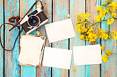 paper photo album on wood table with flowers