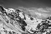 Black and white mountains with glacier in snow at winter sun day