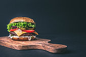 Delicious burger on wood