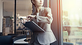 Attractive businesswoman holding a tablet PC.