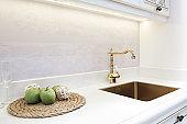 Kitchen luxury retro classic golden faucet. Modern appliances.