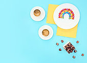 Colorful still life with sweets and present on blue background