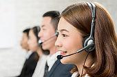Asian woman telemarketing customer service agent team
