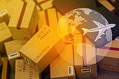grouping Light brown small boxes and cell phone with a plane flies above world map. For ideas about transportation, international freight, global shipping, overseas trade, regional ,local forwarding.