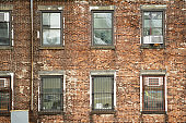 Close-up view of windows of some apartments. Photo taken from the Brooklyn Bridge in Manhattan, New York, USA.