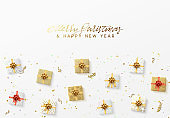 Merry Christmas greeting card. Xmas holiday background, gift box with gold tinsel, bright glitter confetti and golden serpentine