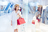 woman looking at shop window display