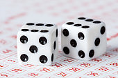 Close-up of dices on lottery ticket