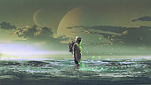 astronaut standing by the sea
