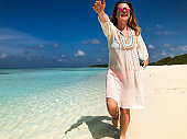 Young Carefree Woman Running on Sandy Beach on Tropical Island
