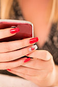 Woman With Polished Fingernails Using Mobile Phone